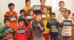 CAFFE primary students with their tablets which they will use to access the BFSS funded app