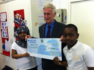 Professor Richard Aldrich presenting a cheque to IntoUniversity's Haringey Centre from the BFSS