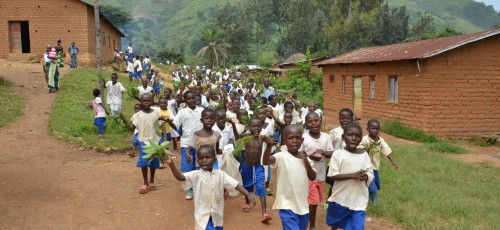Children In Crisis - en route to the inauguration ceremony at Mushegereza Primary School, DRC