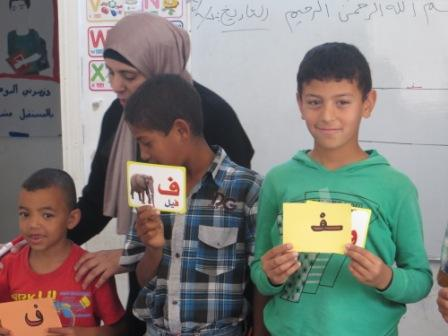 Children enjoying Maths and Arabic classes, delivered in host communities in Irbid, Jordan